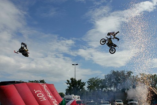 two motorbikes flying on air