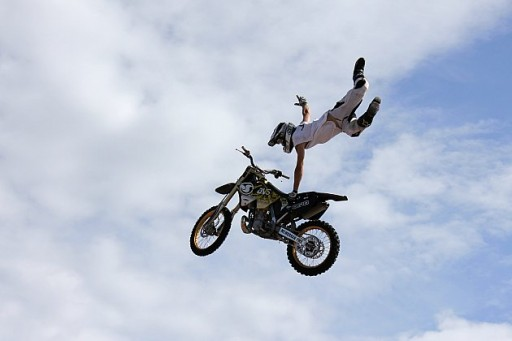 flying in the air with motorbike with one hand off