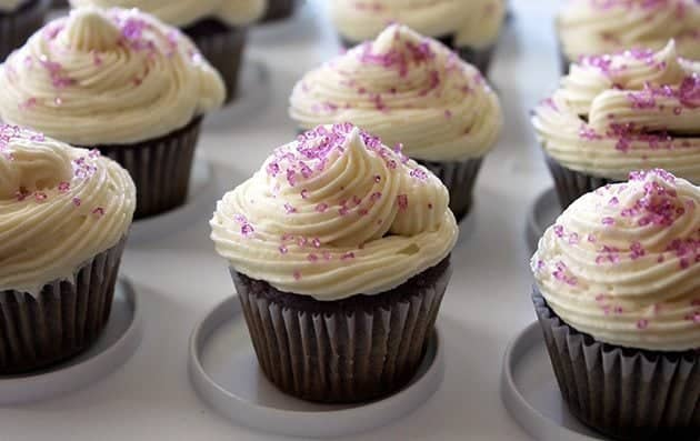 close up of Grape Soda Pop Cupcakes topped with icing and sprinkled with colored sugar