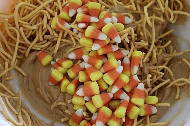 Mixing all together the chow mein noodles, candy corn and melted butterscotch chips