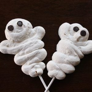 2 pieces ghosts shaped white Meringue Halloween Treats with sticks