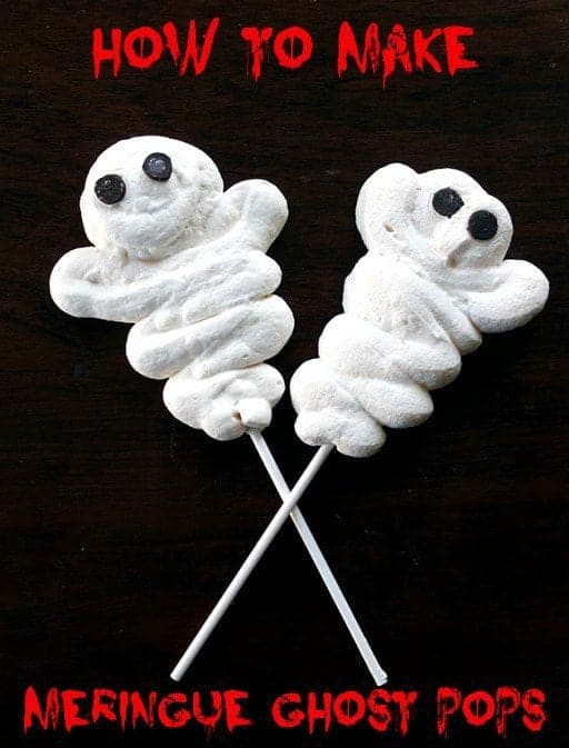 2 pieces white Meringue Halloween Treats with sticks in the center