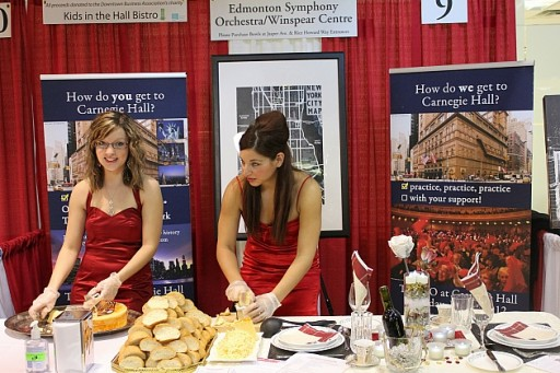 group of two ladies from Edmonton Symphony, wearing red dresses