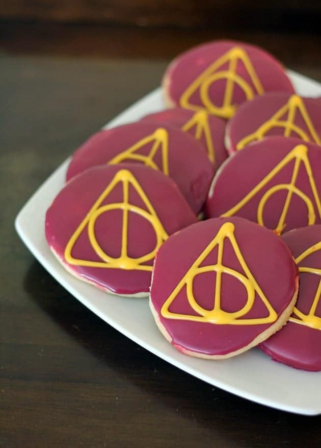 close up pieces of Deathly Hallows Sugar Cookies in white plate