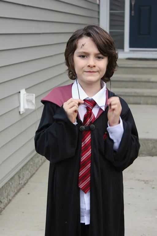little boy wearing a Harry Potter costume