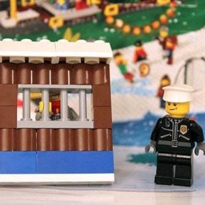 police post lego with the police and prison inside it