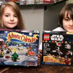 two kids holding their lego boxes