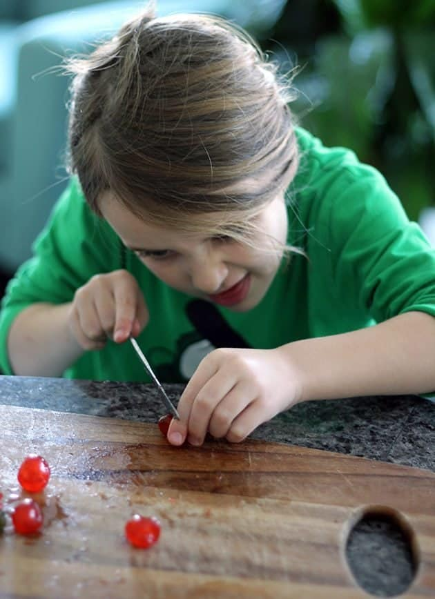 chopping up the candied cherries in a wooden cutting board