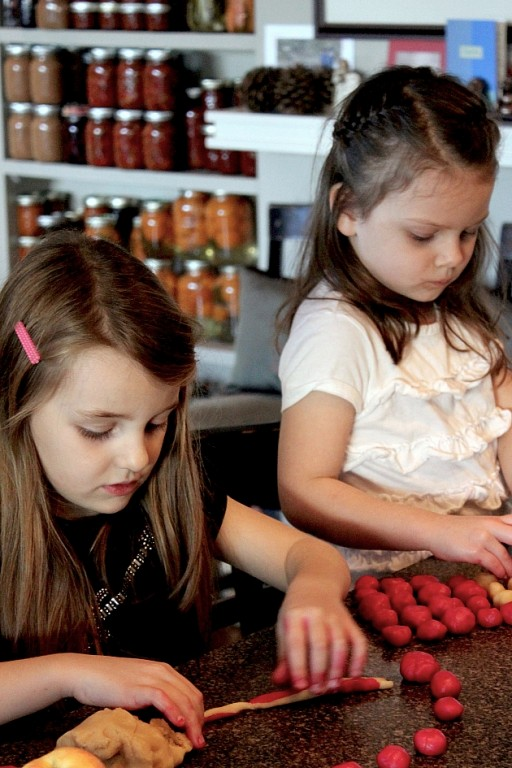 little girls busy doing their baking stuff