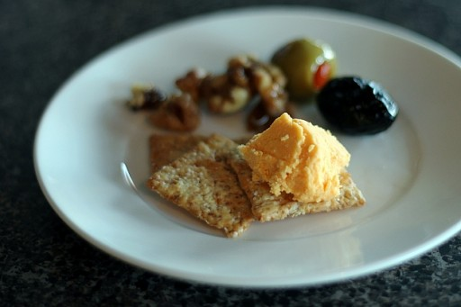 white plate with a serving of bread