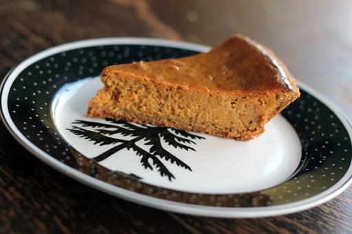 golden brown pumpkin pie slice