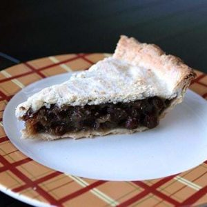 slice of Raisin Pie in a plate with checkered prints
