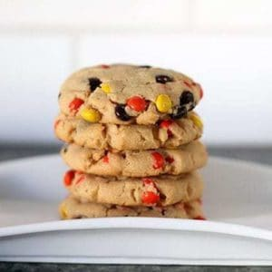 Close up of Stack of Reese's Pieces Peanut Butter Cookies in a white plate