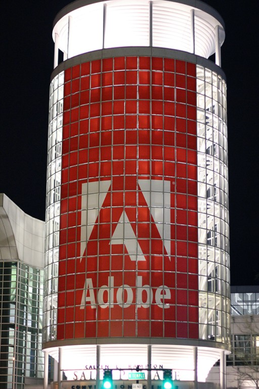 lighted building with adobe logo
