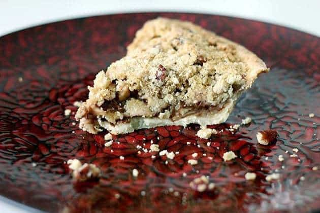 A Slice of Apple Oatmeal Crumble Pie in a Red Plate