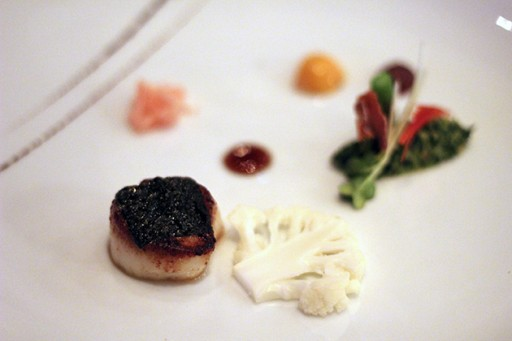 white plate with digby scallop and cauliflower