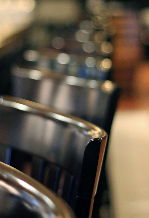 close up shot of the black chairs inside the bar
