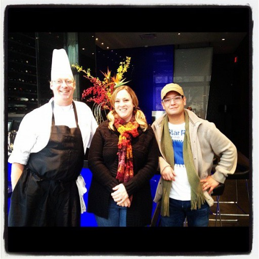 woman in between the two chefs during Culinary Arts Cook Off
