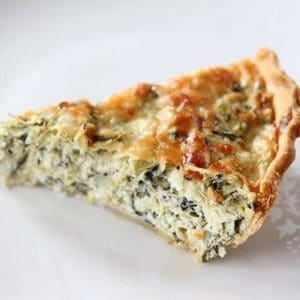 A Slice of Artichoke & Spinach Pie in white Background