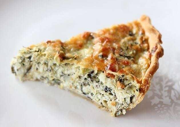 A Slice of Artichoke & Spinach Pie in white Background
