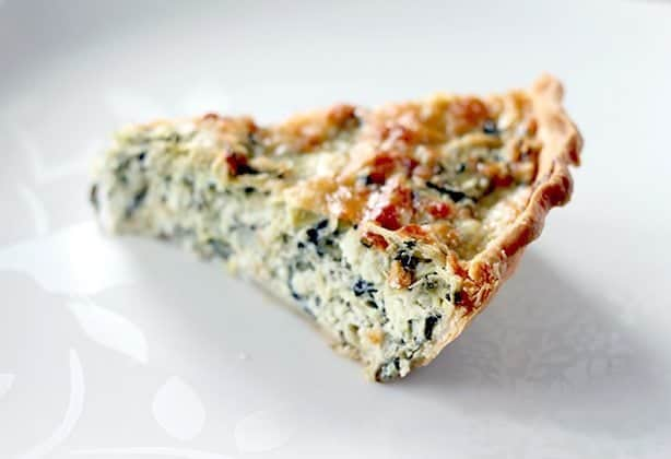 A Slice of Artichoke & Spinach Pie in with golden brown crust