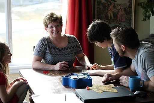 beautiful Aunt together with the kids are sitting around the table