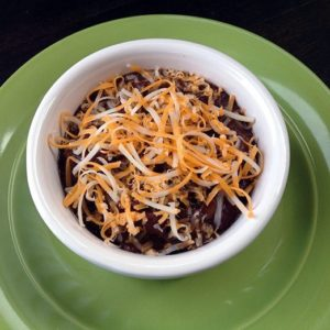 Crock Pot Black Bean Soup in a small white bowl on a green big plate