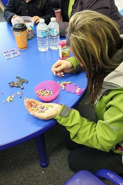 child creating crafts at the blue table