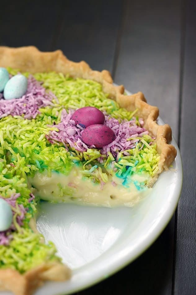 close up of Colorful coconut Custard Easter Pie in a white pie pan