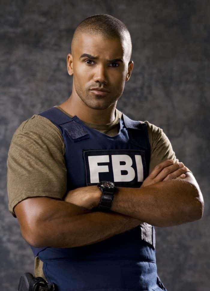 a man in brown shirt wearing an FBI vest