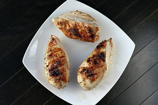 Three Pieces BBQ Chicken Breast in White Plate Ready to Enjoy