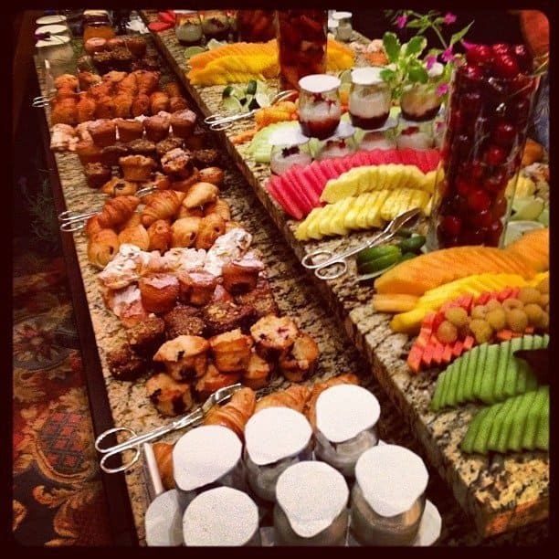 bountiful breakfast set up with fruits, vegetables and muffins