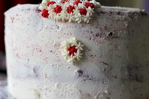 creating the 1st layer of star icing with white and red color on the cake