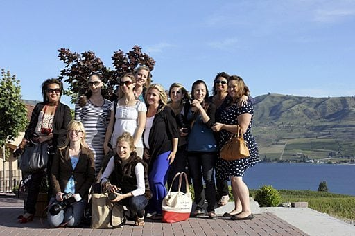 group picture of ladies taken at the winery with the background of mountains