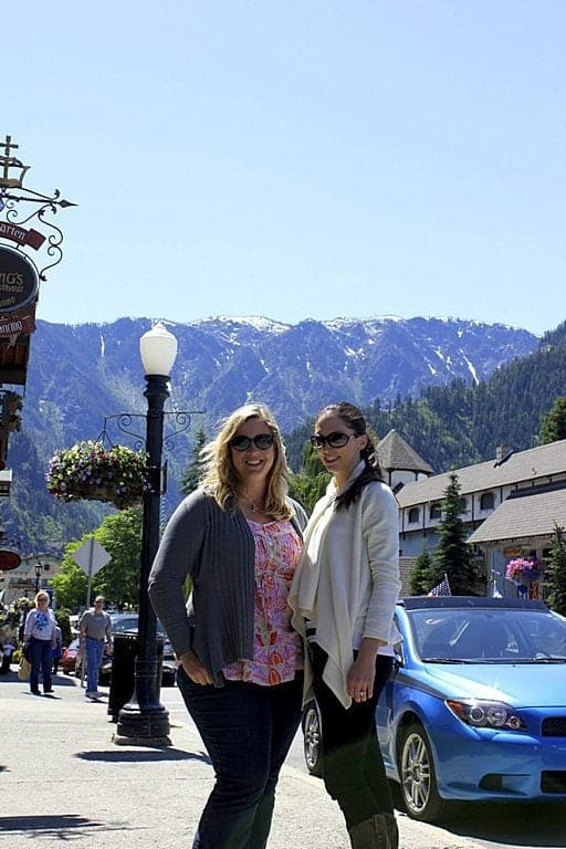 two ladies at the town of Leavenworth with the view of mountains on their background