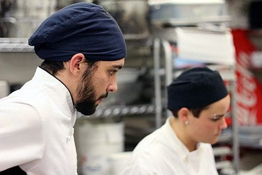 close up of chef with beard, wearing black head cap