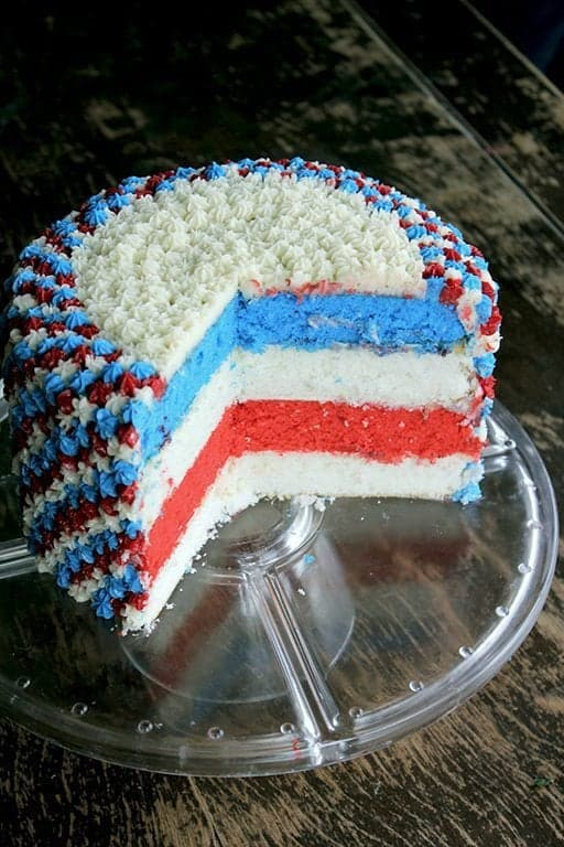 easy fourth of July cake sliced, showing the inner of the cake with red, white and blue color