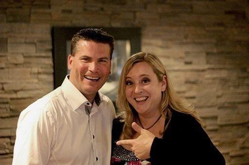 happy woman having a photo with an Edmonton oiler