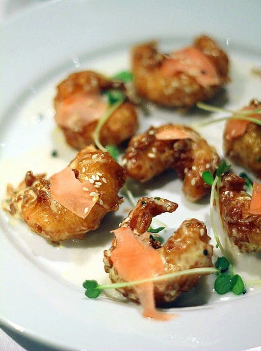 close up of tempura prawns with coconut jelly, pickled ginger and sachimi aioli