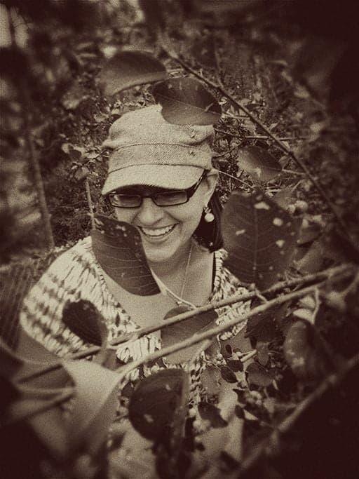 vintage photo of a girl picking Saskatoon berries