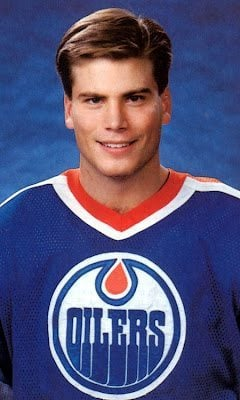 Edmonton oiler wearing blue oilers shirt uniform
