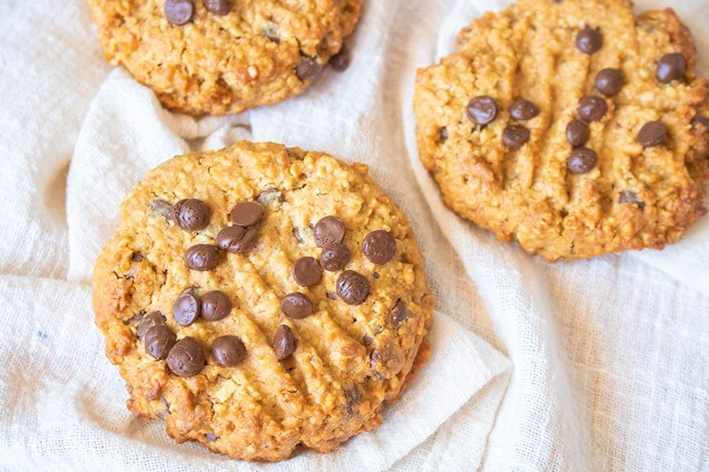 3 pieces Whole Wheat Oatmeal Chocolate Chip Cookies on a white cloth background