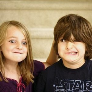 young girl and boy siblings in wacky faces for photo