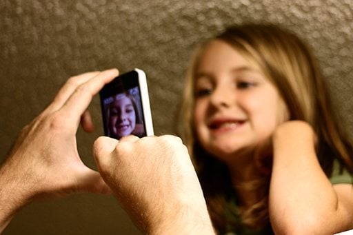 taking a picture with the little girl