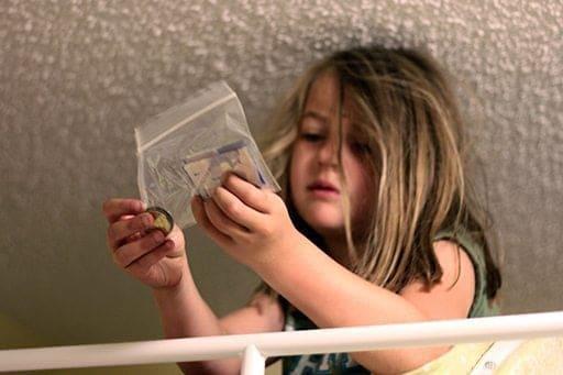 little girl holding a plastic pack