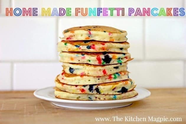 stack of bright and colorful Funfetti Pancakes in a white plate