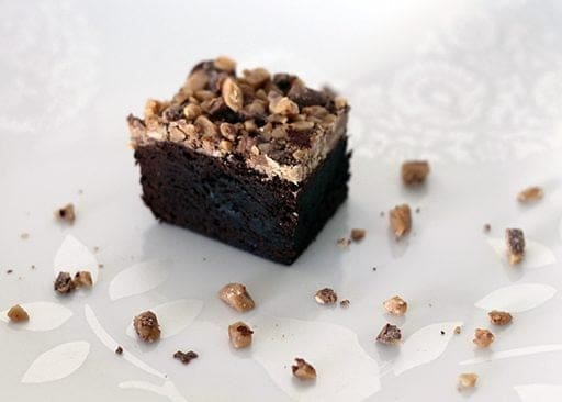top down shot of fudgy Brownies topped with toffee crunch on white background