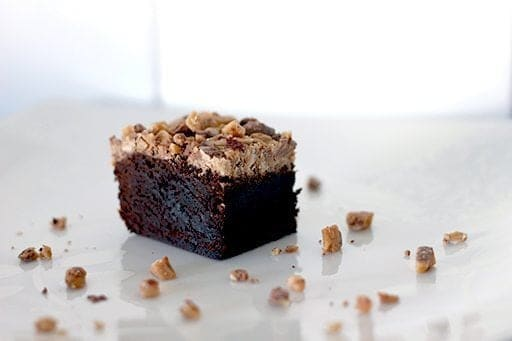 a piece of Heath Toffee Brownies topped with toffee crunch on white background