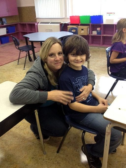 Mom and young son inside the classroom