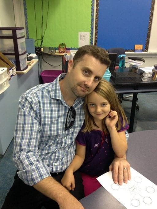 Dad and young daughter inside the classroom